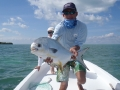 Abbie Marin of GoFish Belize with a nice permit