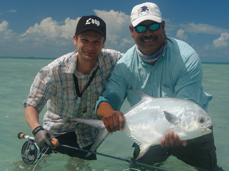 Permit, guide and one very happy angler